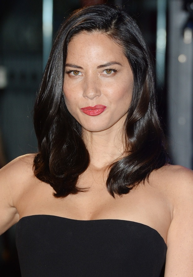 Olivia Munn's hair was swept to one side and fell softly down her shoulders