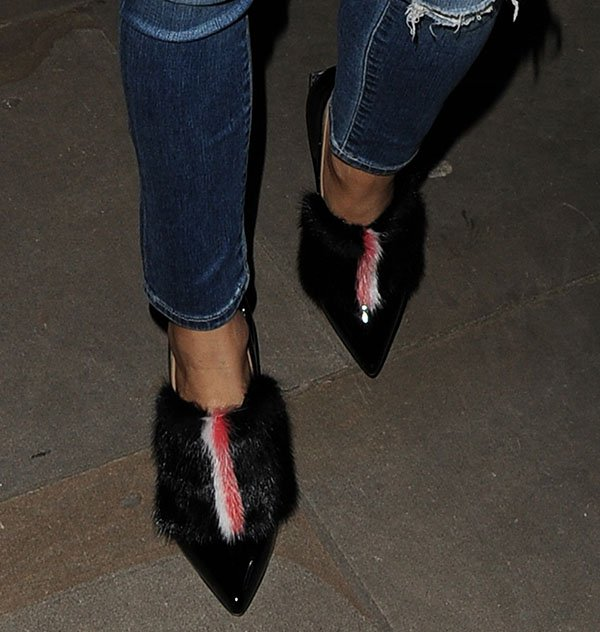 Olivia Palermo wears a pair of Fendi fur-trimmed booties on her feet