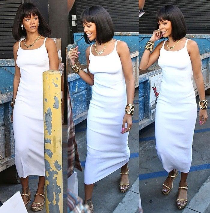 Rihanna trying to escape the paparazzi in a skintight tea-length tank dress
