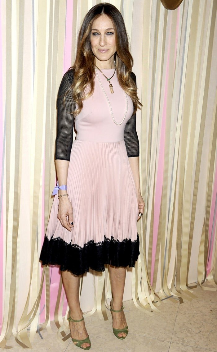 Sarah Jessica Parker wearing green SJP sandals at the opening of the SJP pop-up store in Nordstrom in New York City on February 26, 2014