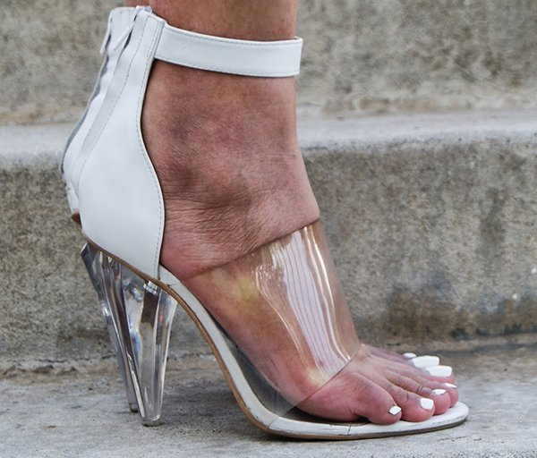 Slim Shay D wearing a pair of sandals with PVC straps and clear cone-shaped heels