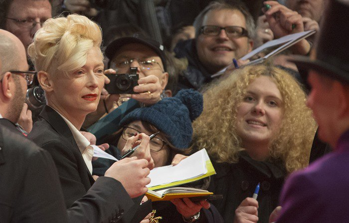 """Tilda Swinton signs autographs for fans at the premiere of """"The Grand Budapest Hotel"""""""