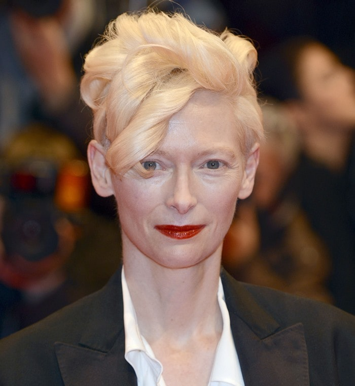 Tilda Swinton wears her hair up in an architectural updo