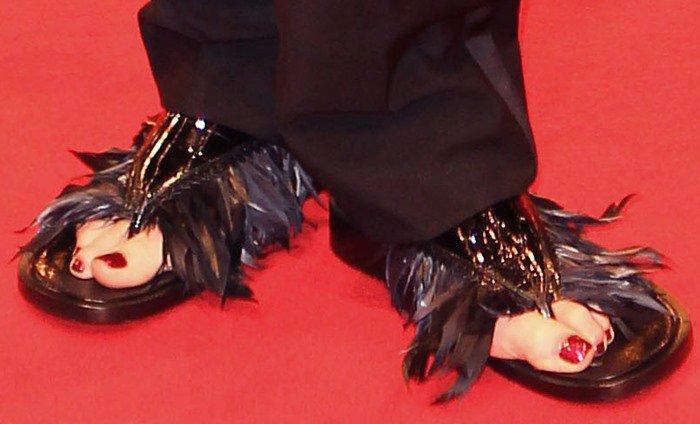 Tilda Swinton's feet in feathered Schiaparelli sandals