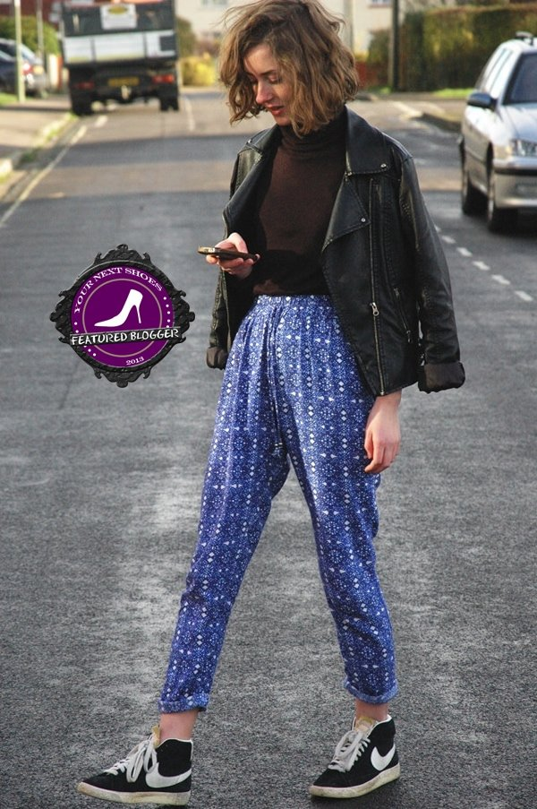 Try wearing your high-waisted printed trousers with a solid-colored turtleneck sweater, and then cover up with a leather jacket draped over your shoulders.
