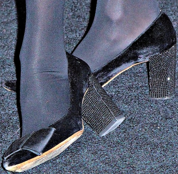 "Alexa Chung in bow-accented ""Beauty"" pumps in black velvet and satin from Louis Vuitton"