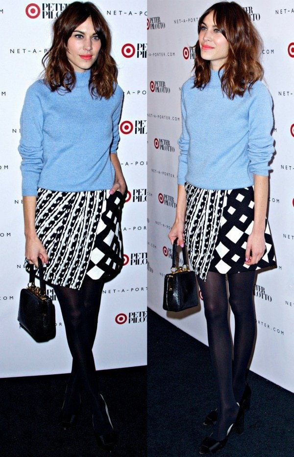 Alexa Chung in a pale blue cashmere sweater from Carven and an asymmetrical miniskirt