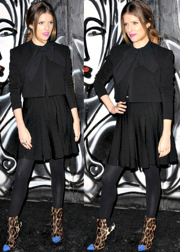 Anna Kendrick in a black cropped blazer with three-quarter sleeves and a bow accent