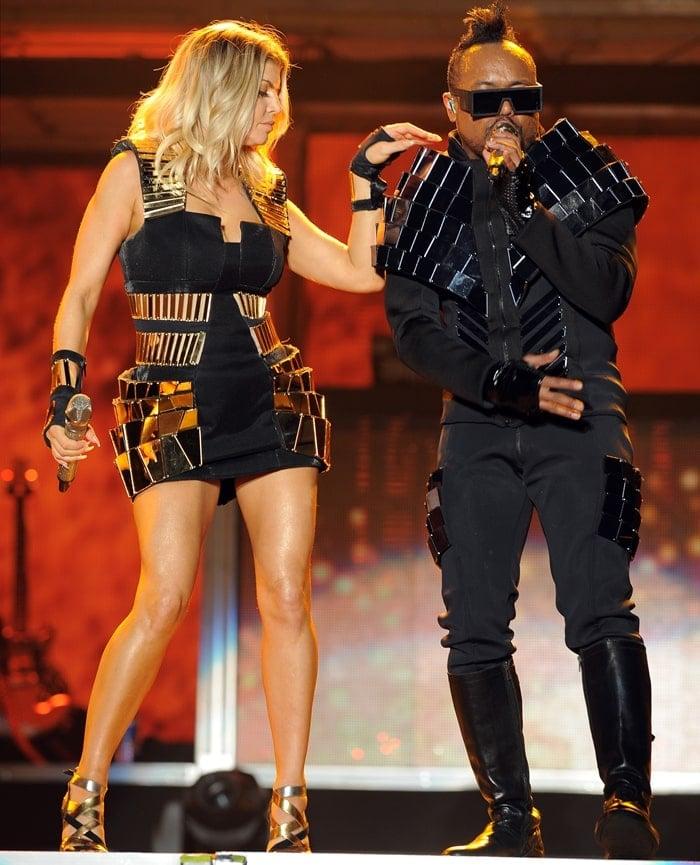 apl.de.ap and Fergie of the Black Eyed Peas perform at Sun Life Stadium