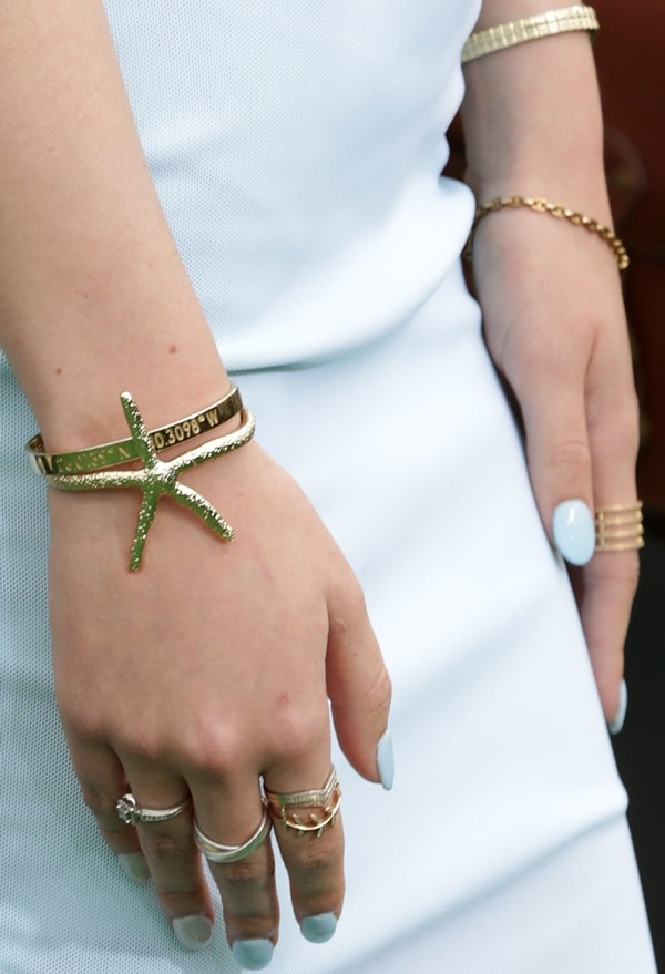 Bella Thorne showing off a starfish cuff bracelet from Pamela V and several rings from Shay Accessories