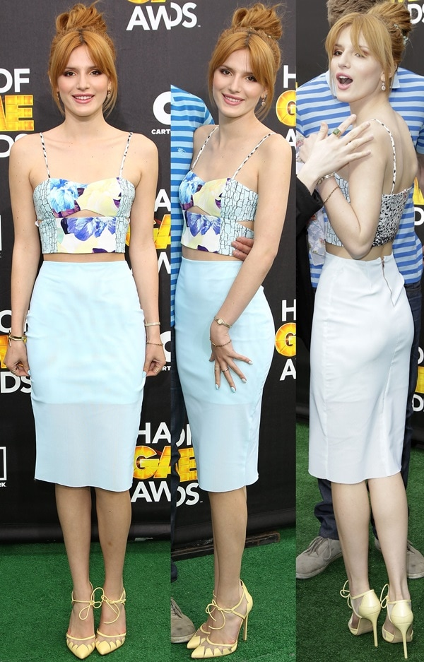 Bella Thorne in a floral-printed cutout crop top and a matching high-waisted pencil skirt