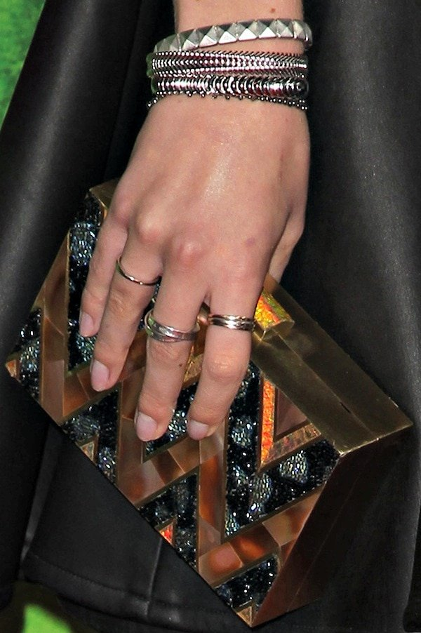 Bella Thorne'sblack-and-gold embellished clutch from Emm Kuo