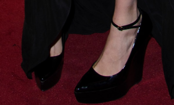 Cara Delevingne shows off her feet in black Chatsworth wedges