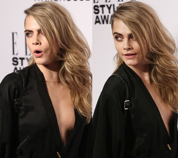 Cara Delevingne in a vintage black gown with a dangerously low neckline