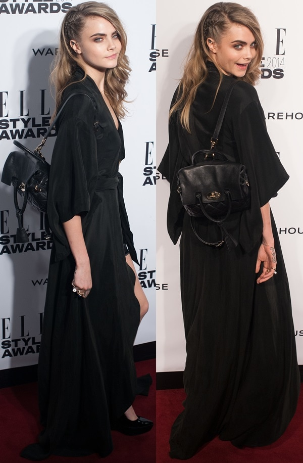 Cara Delevingne proudly displaying one of her bag designs for Mulberry at the 2014 Elle Style Awards held at One Embankment in London, England, on February 18, 2014