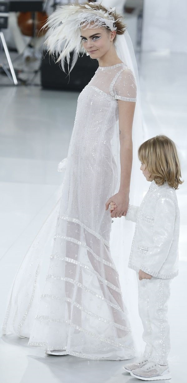 Cara Delevingne had the honor of walking down the runway as a Chanel bride for its finale