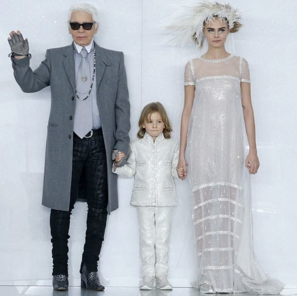 Cara Delevingne with designer Karl Lagerfeld and his godson, Hudson Kroenig, for the Chanel spring/summer 2014 haute couture fashion show finale during Paris Fashion Week held in Paris, France, on January 21, 2014