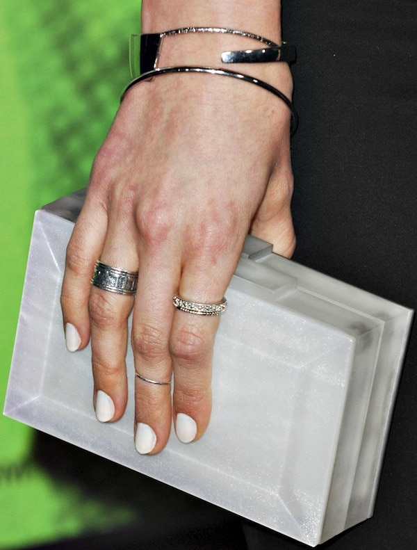 Debby Ryanshowing off herRauwolf clutchand an assortment of rings and bangles