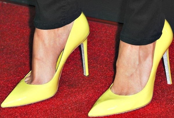 Debby Ryan'sbright yellow patent leather pumps from Rene Caovilla