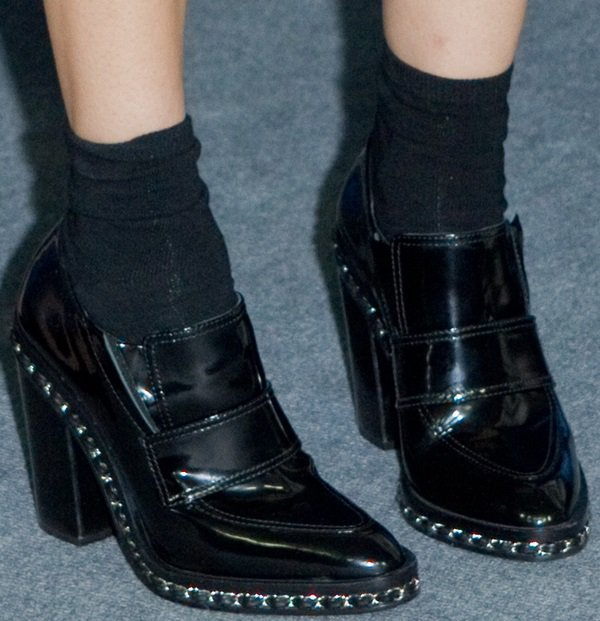 Diane Kruger wore socks and chain-embellished ankle boots