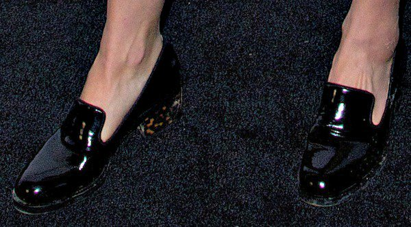 Dree Hemingway'sblack loafers in glossy patent leather