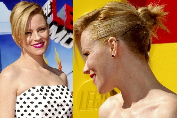 Elizabeth Banks'hair was swept to one side and styled in a messy bun to show off her ear cuff from Jack Vartanian
