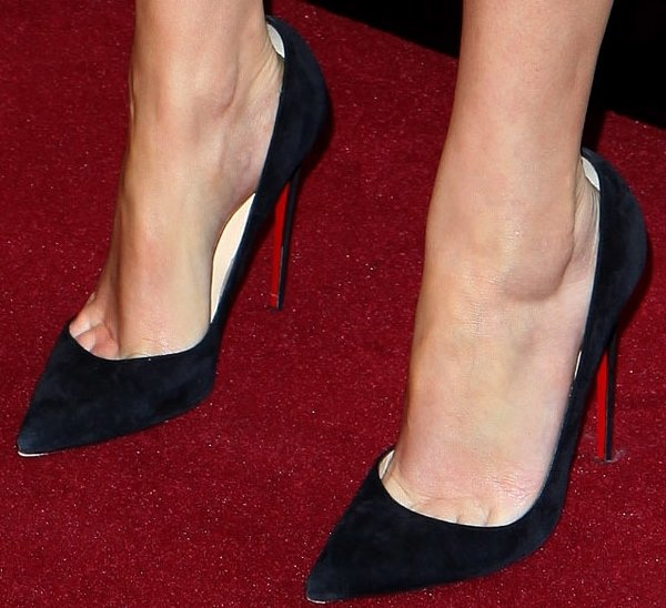 Emma Watson's feet in black pumps from Christian Louboutin