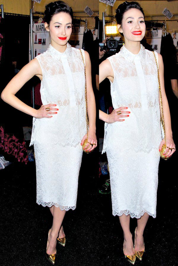 Emmy Rossum in a sleeveless, collared sheer blouse over a white bandeau and a pencil skirt