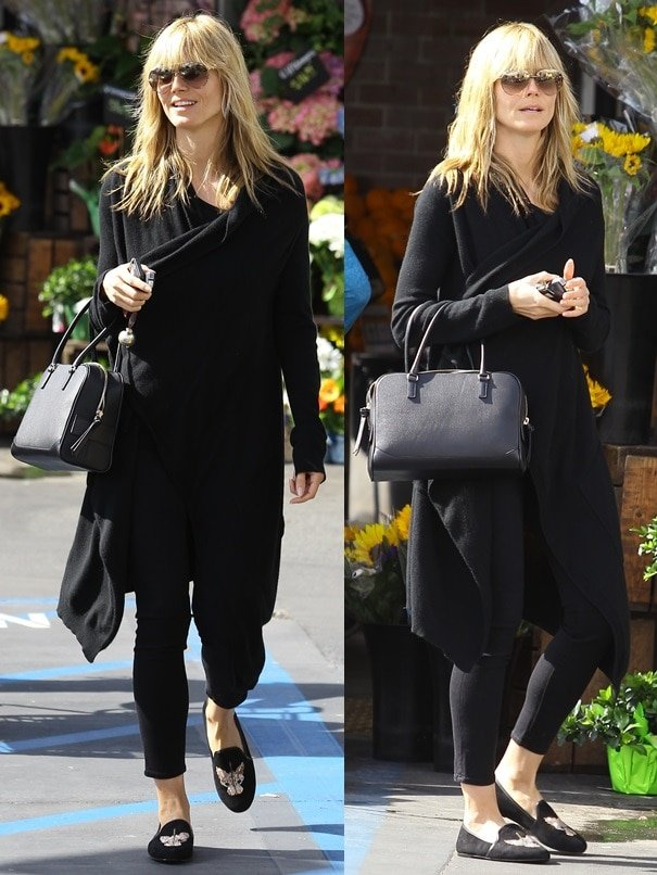 Heidi Klum went makeup-free and slipped into a long black drapey coat over some black cropped skinnies