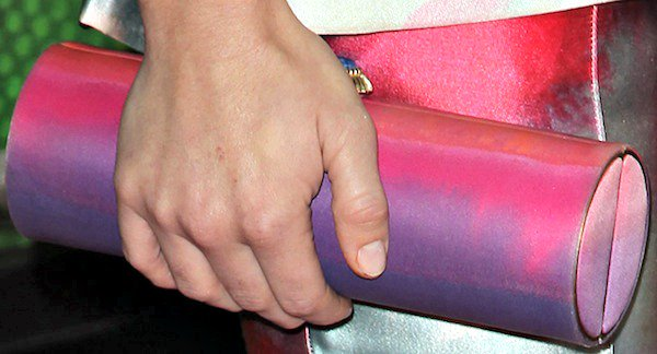 Holland Roden carried a hand-painted roll clutch from Amanda Pearl