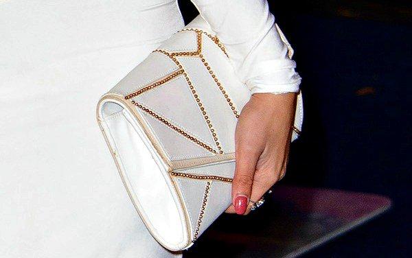 Jasmin Walia totes a white clutch