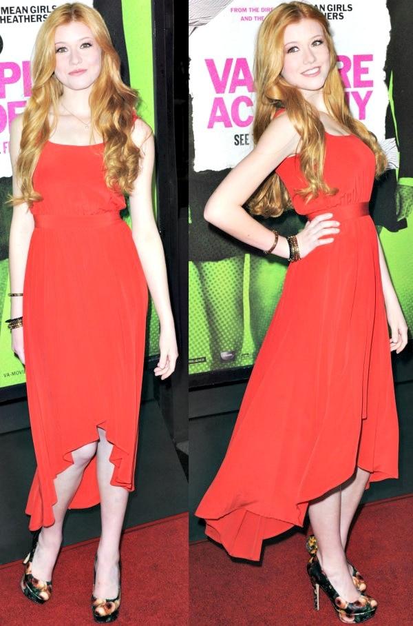 Katherine McNamarain a red asymmetrical dress from Rebecca Minkoff