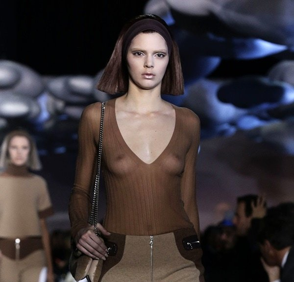 The barely recognizable Kendall Jenner as she bares her nipples for the Marc Jacobs Fall 2014 presentation