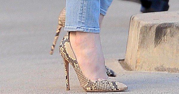 Khloe Kardashian wearing python pumps