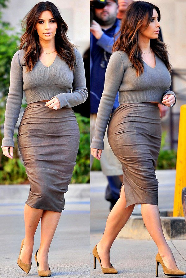 Kim Kardashian wearing a long-sleeved crop top with a V-shaped neckline and a ribbed hemline