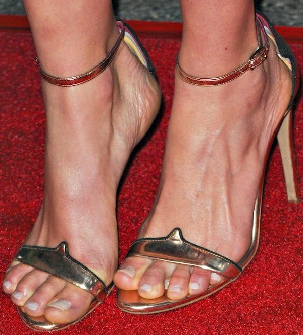 "Lucy Fry's feet inOscar Tiye ""Petra"" sandals in rose gold"
