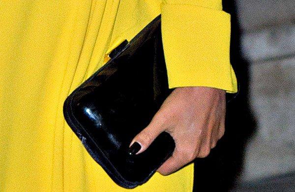 Preeya Kalidas carrying a black clutch