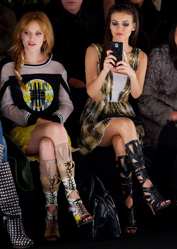 Victoria Justice and Bella Thorne sitting front row at the Rebecca Minkoff fashion show during Mercedes Benz Fashion Week in New York City on February 7, 2014