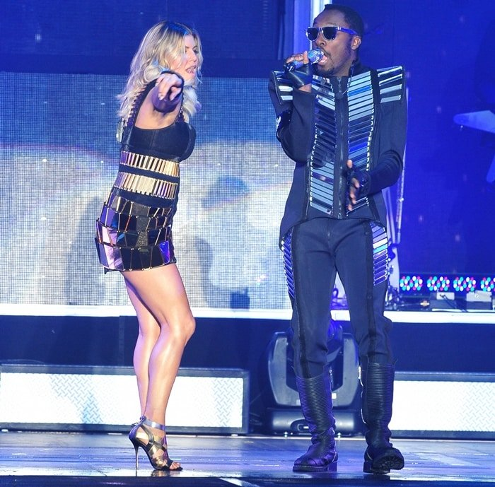 will.i.am and Fergie aka Stacy Ferguson of The Black Eyed Peas perform in concert