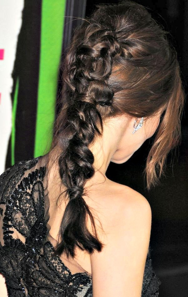Zoey Deutch'shair was swept to one side and styled in an intricate braid