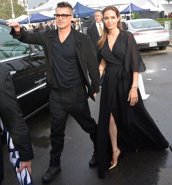 Angelina Jolie looked stunning in a black ruffled wrap gown from her favorite label, Saint Laurent