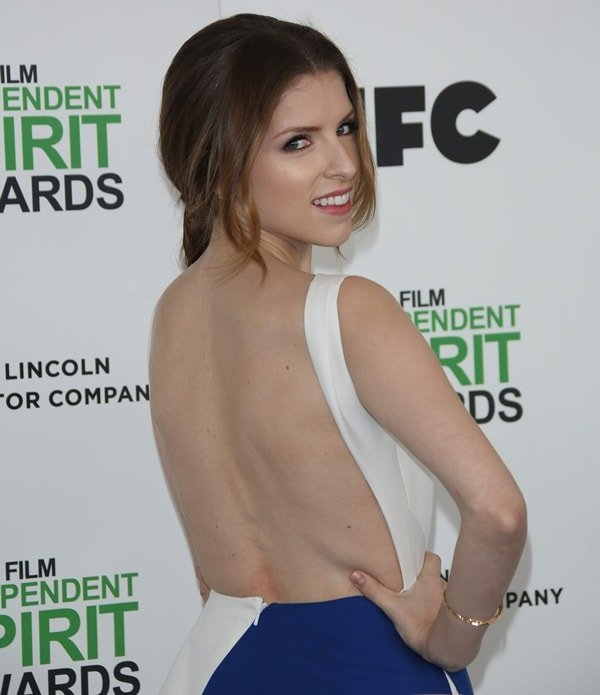 Anna Kendrick showing off her open back dress