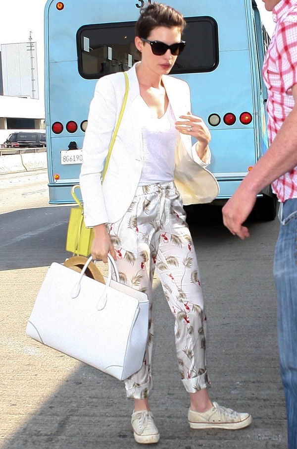 Anne Hathaway in Piamita pants featuring monkeys and palm trees