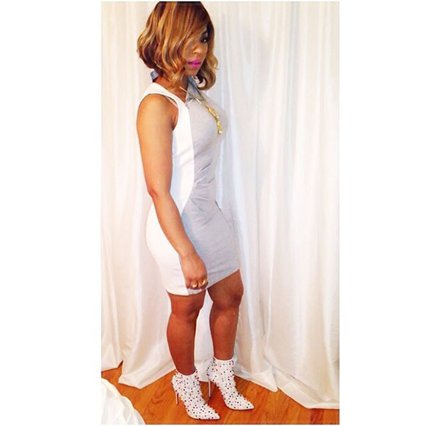 Ashanti wearing a gray-and-white mini dress, which she styled with gold accessories