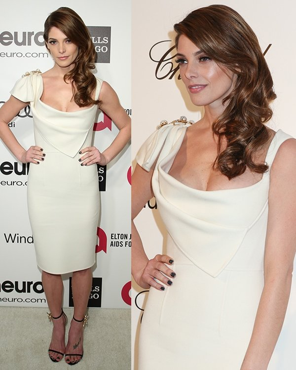 Ashley Greenein a sleek white dress by Dsquared2 featuring a crystal-embellished brooch on the right shoulder