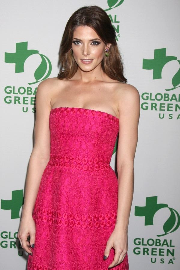 Ashley Greene wearing dazzling green earrings