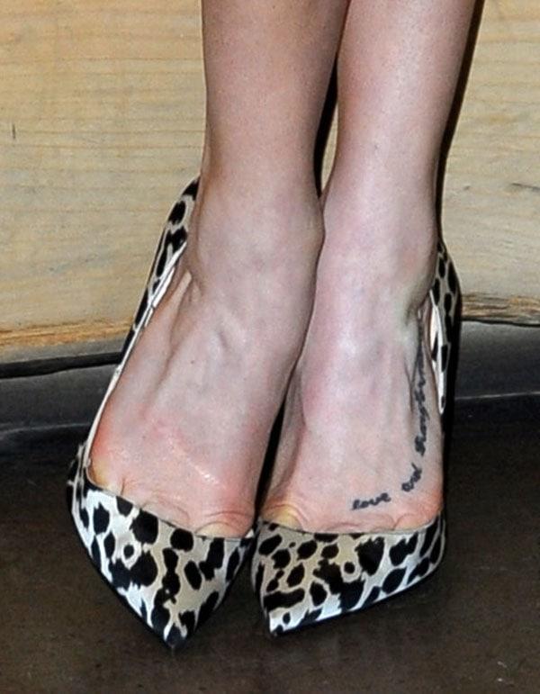 "Ashley Roberts's toe cleavage in leopard-print ""Iriza"" pumps"