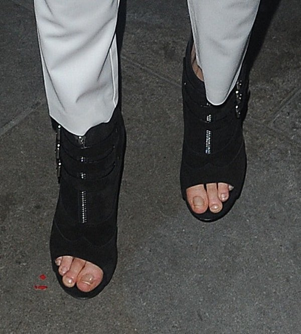 Cara Delevingne shows off her ugly feet in open-toed booties