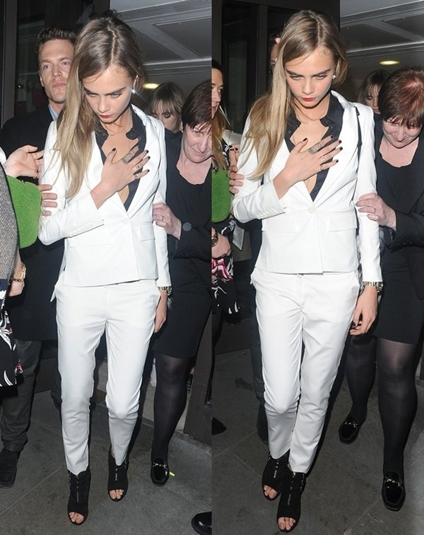 Cara Delevingne in a buttoned-down inner blouse that added major oomph to her ensemble