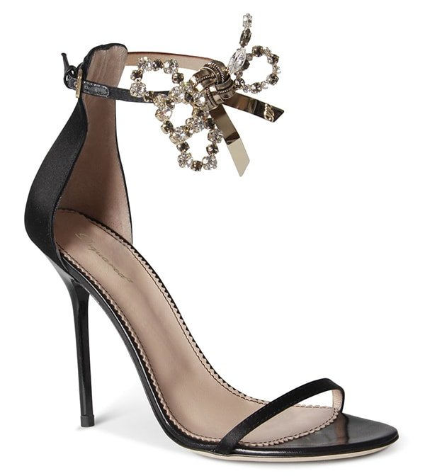 What makes them striking are the rhinestone-embellished bows at the ankles